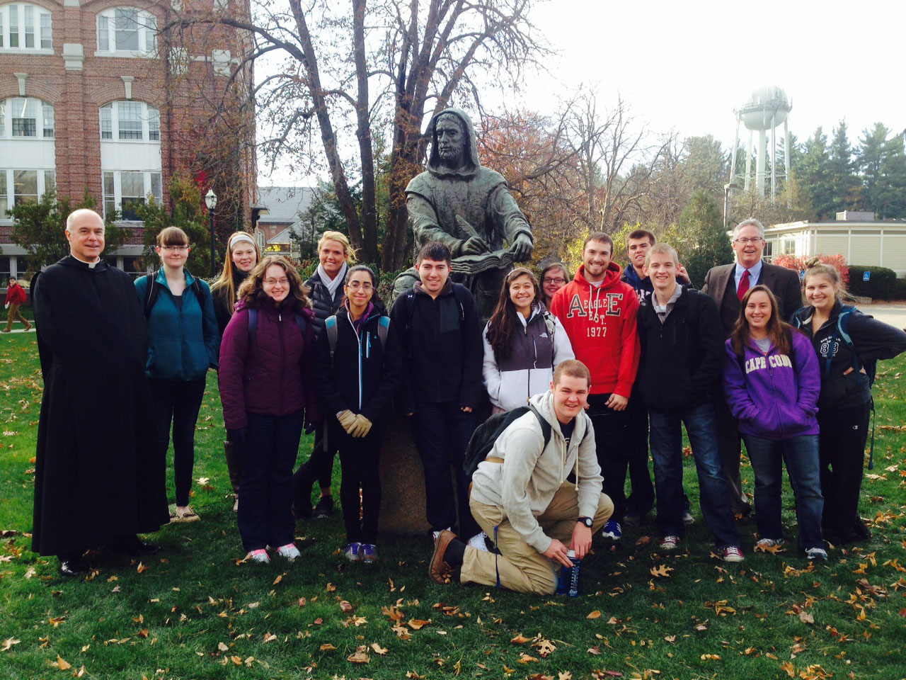 Conversatio students and faculty in front of Saint Augustine statue.