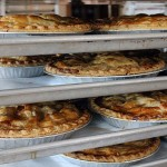 Fresh baked apple pies await boxes