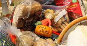 An ornament is seen in a donated Thanksgiving basket