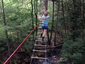 Kelsey on a high-ropes element